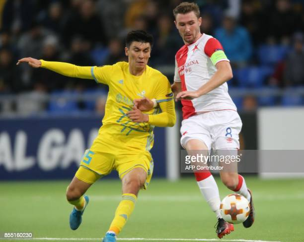 Astana's defender from Kazakhstan Abzal Beisebekov and Slavia Prague's midfielder from Czech Republic Jaromir Zmrhal vie for the ball during the UEFA...