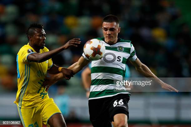 Astana's forward Patrick Twumasi vies for the ball with Sporting's midfielder Joao Palhinha during UEFA Europa League round of 32 second leg football...