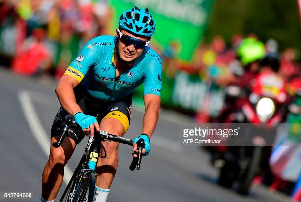 Astana's Kazakh cyclist Alexey Lutsenko crosses the finish line of the 18th stage of the 72nd edition of La Vuelta Tour of Spain cycling race a 169...