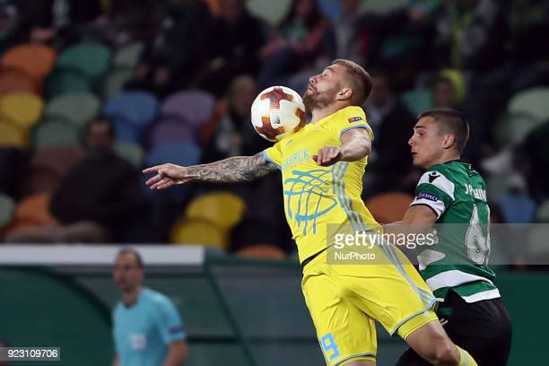 Astanas midfielder Aleksei Schetkin vies with Sporting's midfielder Joao Palhinha from Portugal during the UEFA Europa League round of 32 second leg...