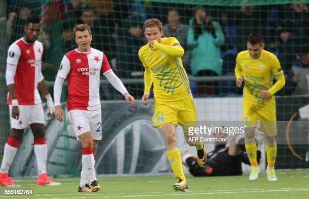Astana's midfielder from Croatia Marin Tomasov celebrates after scoring a goal during the UEFA Europa League Group A football match between FC Astana...