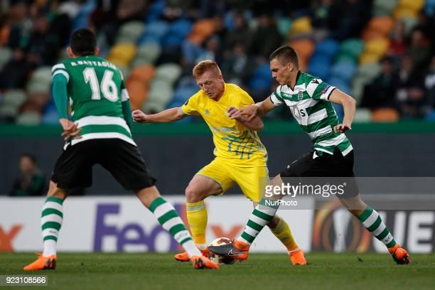 Astana's midfielder Laszlo Tleinheisler vies for the ball Sporting's midfielder Joao Palhinha and Sporting's midfielder Rodrigo Battaglia with during...