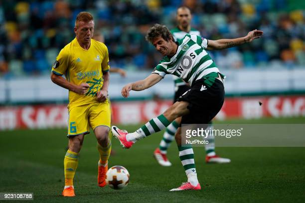 Astana's midfielder Laszlo Tleinheisler vies for the ball with Sporting's defender Fabio Coentrao during UEFA Europa League round of 32 second leg...