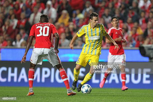 Astana's midfielder Nemanja Maksimovic tries to escape Benfica's midfielder Anderson Talisca during the match between SL Benfica and FC Astana for...
