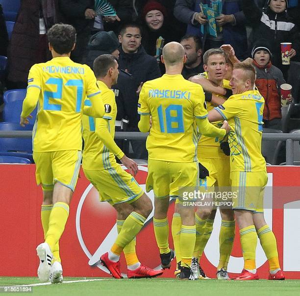 Astana's players celebrate after Croatian midfielder Marin Tomasov opened the scoring during the Europa League Round of 32 first leg football match...