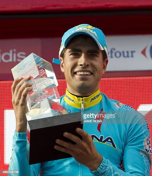 Astana's Spanish cyclist Mikel Landa celebrates on the podium after winning the 11th Stage of the 2015 Vuelta Espana cycling tour a 138km route...