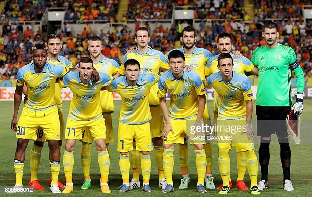 Astana's starting eleven pose for a group picture ahead of their UEFA Europa League Group B football match between Cyprus' APOEL Nicosia and...