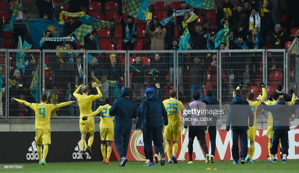 Astana's team celebrates with fans after the UEFA Europa League group A football match Slavia Prague vs Astana in Prague, Czech Republic, on December 7, 2017. PHOTO / Michal CIZEK