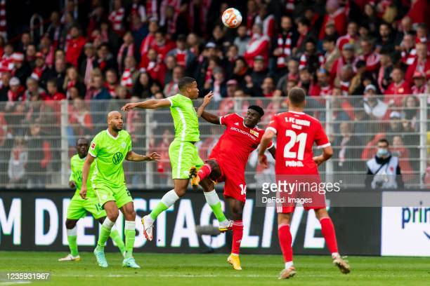 Aster Vranckx of VfL Wolfsburg and Taiwo Awoniyi of 1. FC Union Berlin battle for the ball during the Bundesliga match between 1. FC Union Berlin and...