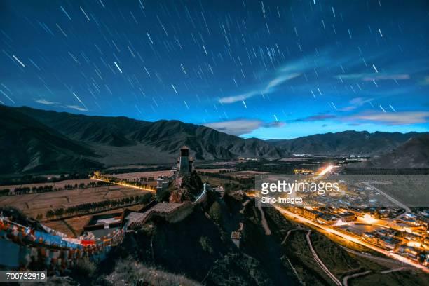 Asteroid rain over illuminated town