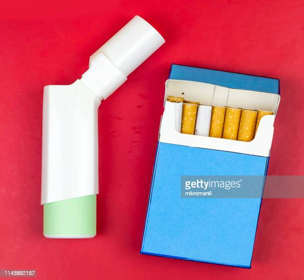 asthma inhaler and cigarette - cigarette pack stock pictures, royalty-free photos & images