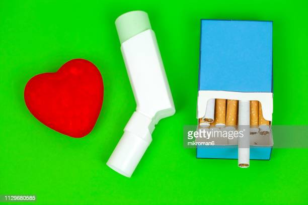 asthma inhaler, cigarette and red heart - cartoon cancer stock pictures, royalty-free photos & images