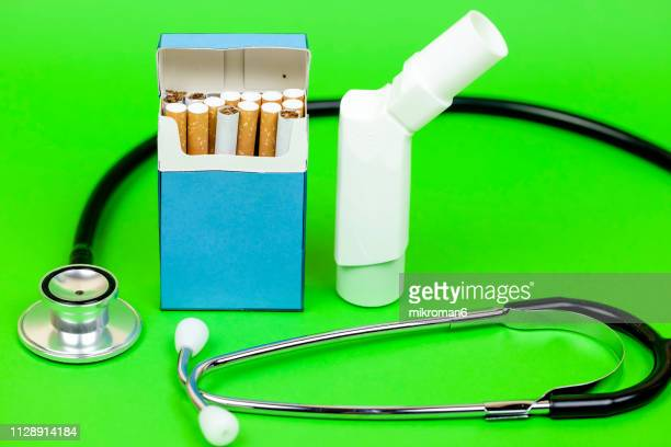 asthma inhaler, cigarette and stethoscope - cartoon cancer stock pictures, royalty-free photos & images