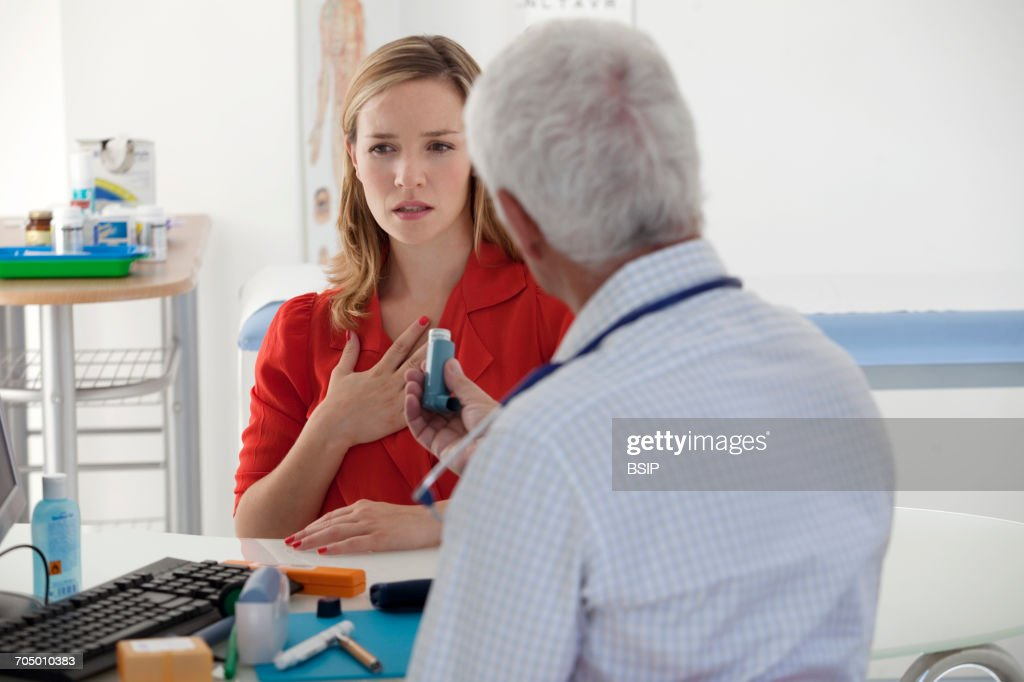 Asthma treatment, woman : Stock Photo
