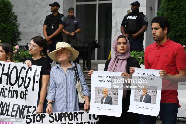 Asthma Yousef right center and her nephew Abdulaziz Gebril right join with others in a rally about the disappearance of Washington Post journalist...