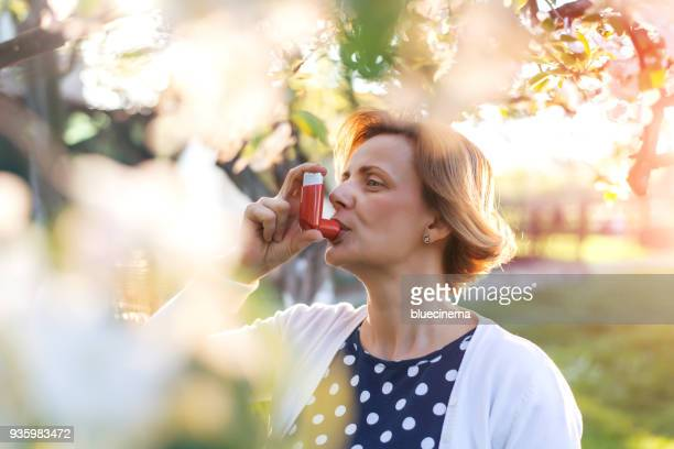 asthmatic inhaler - asthmatic stock photos and pictures