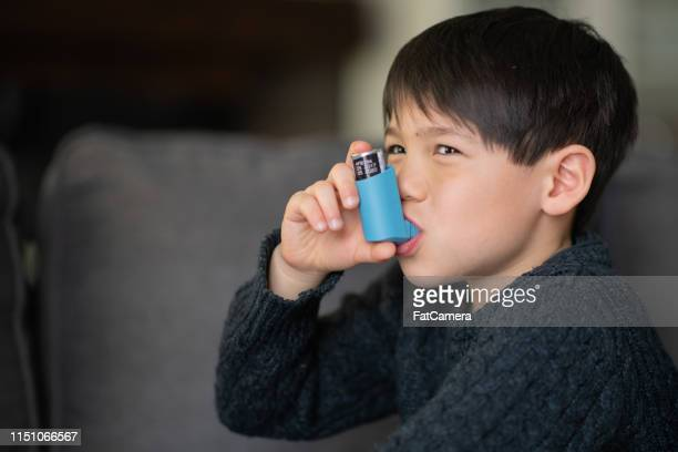 asthmatic little boy - asthma inhaler stock pictures, royalty-free photos & images