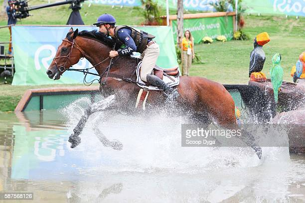 Astier Nicolas of France riding Piafde B'Neville clears a jump during the Cross Country Eventing on Day 3 of the Rio 2016 Olympic Games at the...