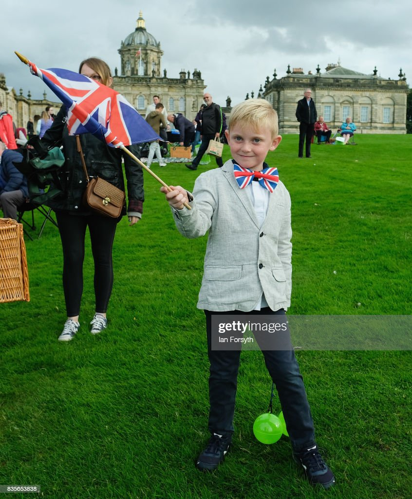 Aston Hart, 7, from York waves his flag as he attends the annual Castle Howard Proms Spectacular concert held on the grounds of the Castle Howard estate on August 19, 2017 in York, England. The outdoor picnic concert celebrated the best of British with a rousing medley of traditional orchestral anthems from the London Gala Orchestra conducted by Stephen Ellery and special guest performances from Brit award winners Blake and soprano Joanne Forest.