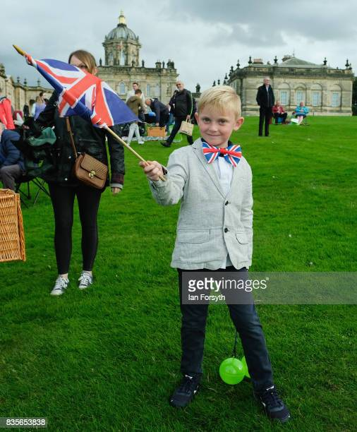 Aston Hart from York waves his flag as he attends the annual Castle Howard Proms Spectacular concert held on the grounds of the Castle Howard estate...