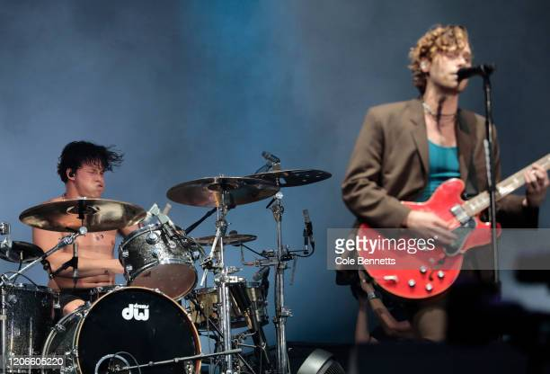 Aston Irwin and Luke Hemmings of 5 Seconds of Summer perform during Fire Fight Australia at ANZ Stadium on February 16, 2020 in Sydney, Australia.