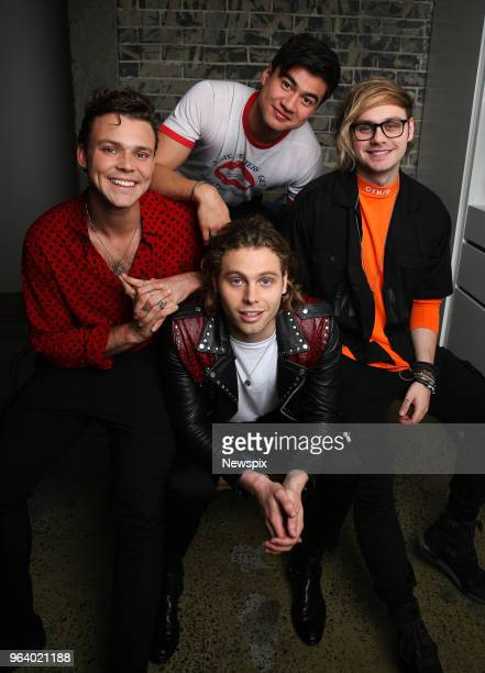SYDNEY NSW Aston Irwin Luke Hemmings Calum Hood and Michael Clifford of Five Seconds Of Summer pose during a photo shoot in Sydney New South Wales