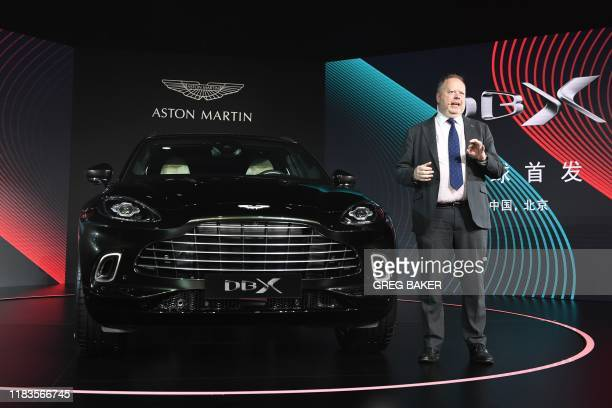 Aston Martin CEO Andy Palmer speaks at the world premiere of the Aston Martin DBX SUV in Beijing on November 20 2019 Aston Martin launched its first...
