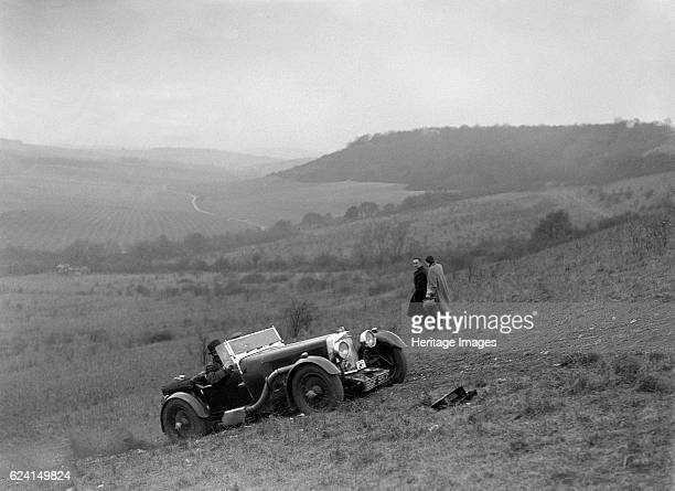 Aston Martin competing in the London Motor Club Coventry Cup Trial Knatts Hill Kent 1938 Artist Bill BrunellAston Martin 1496 cc Vehicle Reg No...