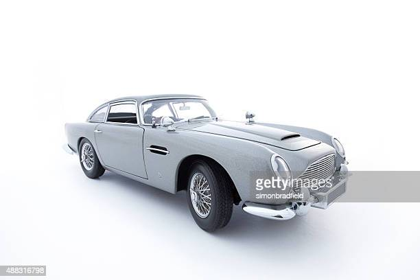 aston martin db5 model on white - james bond fictional character stock pictures, royalty-free photos & images