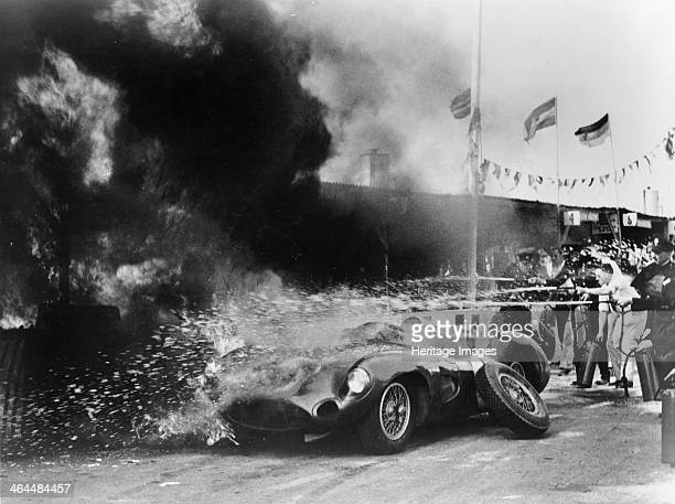 Aston Martin DBR1 on fire in the pits Tourist Trophy Race Goodwood Sussex 1959 At a refuelling stop with Roy Salvadori handing over to Stirling Moss...