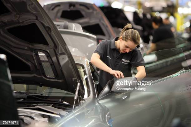 Aston Martin motor cars roll off the production line at the companies new assembly plant on January 23 2008 in Gaydon England The luxury range of...