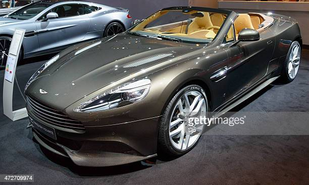 aston martin vanquish volaten sports car front view - v12 stock photos and pictures