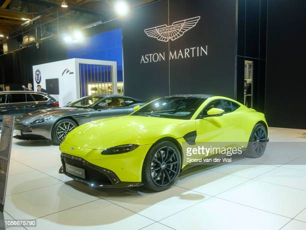 Aston Martin Vantage in bright green and Aston Martin DB11 coupe sports cars on display at Brussels Expo on January 10 2018 in Brussels Belgium The...