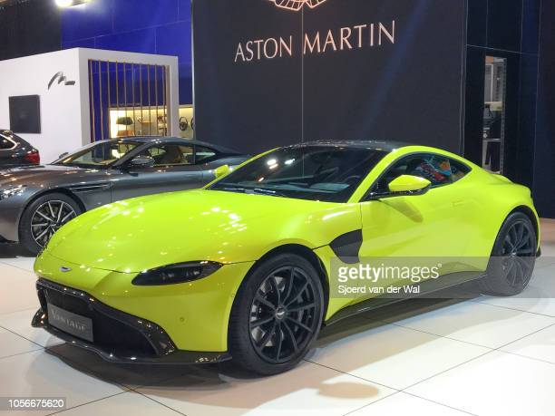 Aston Martin Vantage in bright greenon display at Brussels Expo on January 10 2018 in Brussels Belgium The Aston Martin Vantage is fitted with a 40...