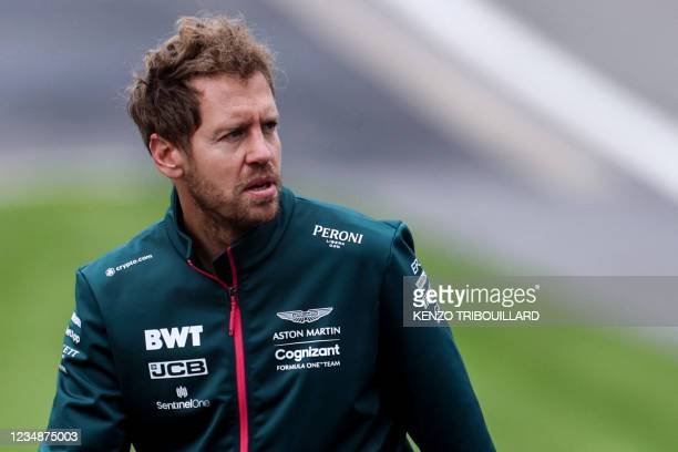 Aston Martin's German driver Sebastian Vettel walks along the Spa-Francorchamps circuit in Spa during previews, ahead of the F1 2021 Belgian Grand...