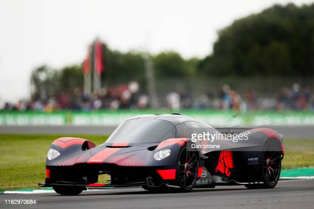 Aston Martin's high performance test driver Chris Goodwin drives the Aston Martin Valkyrie hypercar on track after final practice for the F1 Grand...