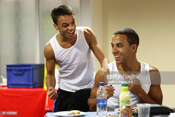 Aston Merrygold and Marvin Humes of JLS relax backstage ahead of a dress rehearsal show prior to the opening night of their JLS 2010 UK Tour
