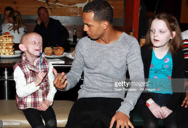 Aston Merrygold from JLS with Progeria suffer Ashanti ElliottSmith from Burgess Hill and Cystic Fibrosis suffer Chloe Bennet from Borehamwood at...