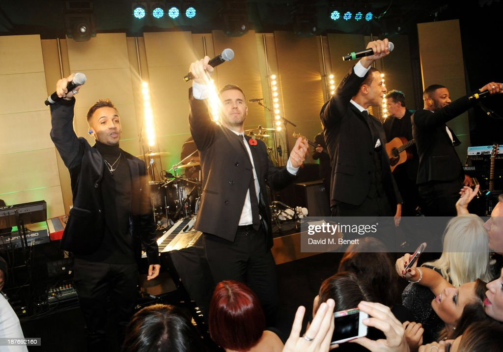 Aston Merrygold, Gary Barlow, Marvin Humes and Jonathan 'JB' Gill perform at the BBC Children in Need Gala hosted by Gary Barlow at The Grosvenor House Hotel on November 11, 2013 in London, England.