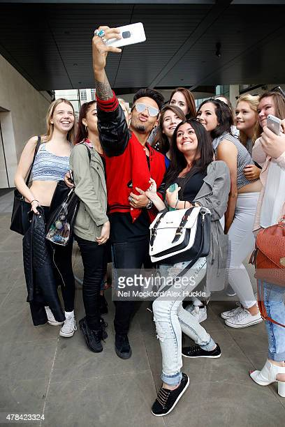 Aston Merrygold poses for pictures with fans at the BBC Radio 1 Studios on June 25 2015 in London England Photo by Neil Mockford/Alex Huckle/GC Images