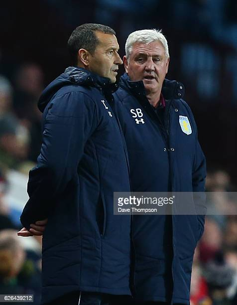 Aston Villa assistant manager Colin Calderwood and manager Steve Bruce during the Sky Bet Championship match between Aston Villa and Cardiff City at...