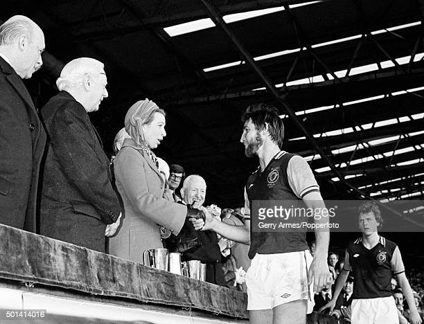 Aston Villa captain Chris Nicholl shaking hands with HRH Princess Anne after the League Cup Final at Wembley Stadium in London 12th March 1977 The...