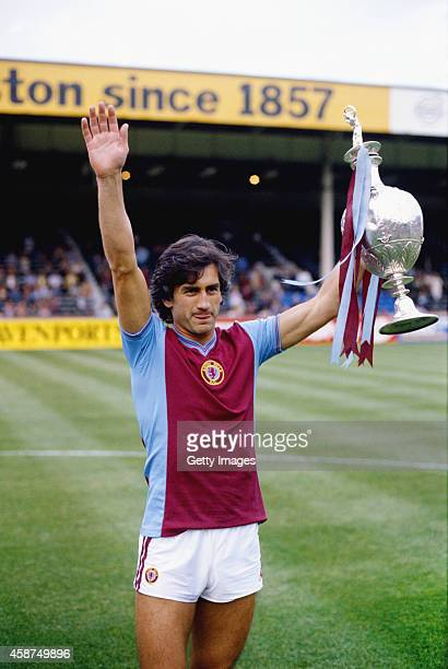 Aston Villa captain Dennis Mortimer holds aloft the Division 1 League Championship trophy at Villa Park won by Villa in season 19801981 Mortimer...