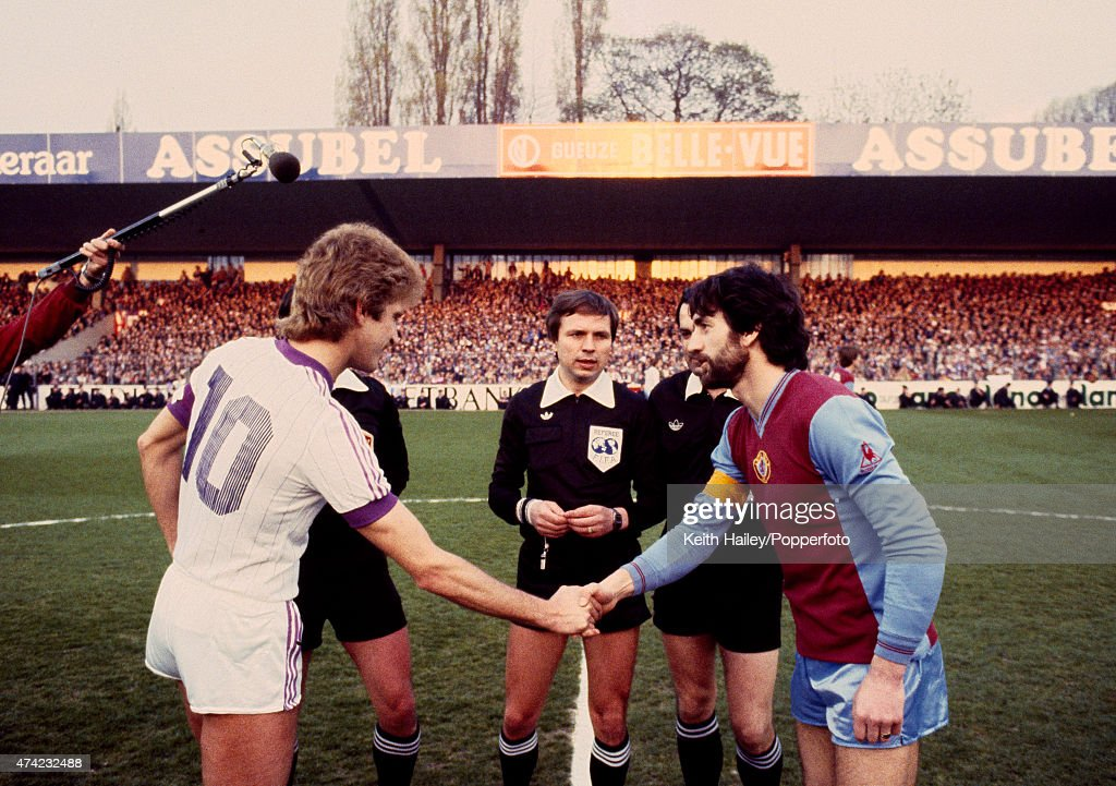 Aston Villa captain Dennis Mortimer (right) meets Ludo Coeck of Anderlecht prior to the European Cup Semi-final 2nd leg match between Anderlecht and Aston Villa held at Constant Vanden Stock Stadium, Brussels on 21st April 1982. The referee is Duan Krchnak. The match ended in a 0-0 draw, but Aston Villa won 1-0 on aggregate.