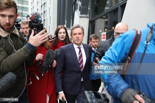 Aston Villa Chief Executive Christian Purslow is surrounded by members of the media outside the headquarters of the English Premier League in London...