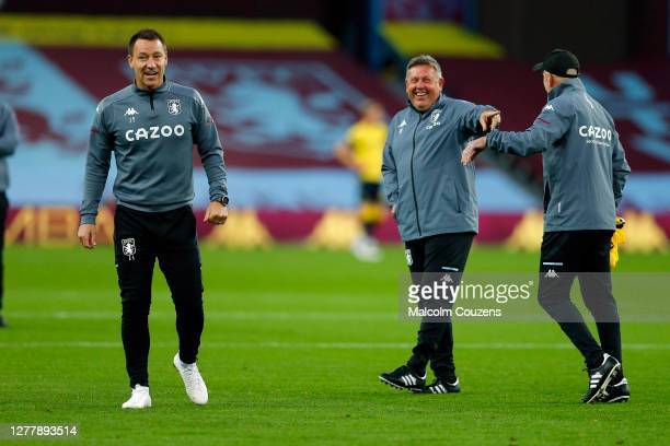 Aston Villa coaches John Terry, Craig Shakespeare and Richard O'Kelly react in the warm-up before the Carabao Cup fourth round match between Aston...