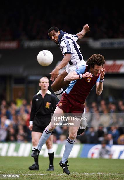 Aston Villa defender Allan Evans is beaten to the ball by West Brom striker Cyrille Regis during a League Division One match between Aston Villa and...