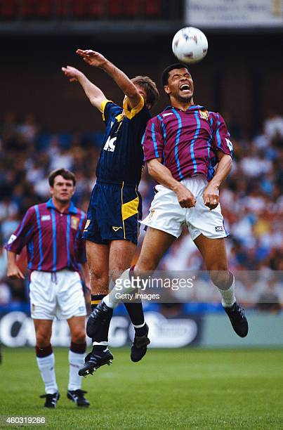 Aston Villa defender Paul McGrath beats Alan Kimble of Wimbledon to the ball during an Premier League match at Selhurst Park on August 21 1993 in...
