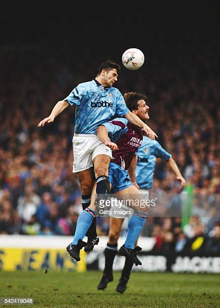 Aston Villa defender Shaun Teale is beaten to the ball by David White of Manchester City during a League Divison One match at Maine Road on February...
