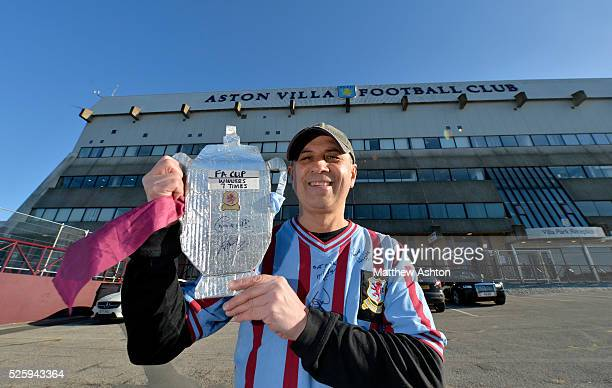 Aston Villa fan Andy Turnstile from Birmingham with his silver foil FA Cup